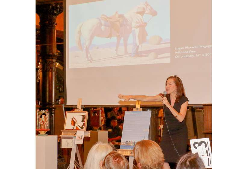 "Auctioneer Alissa Ford fires up the crowd for Logan Maxwell Hagege's ""Wild and Free,"" which was the 2017 Gala's co-top gainer at $12,000."