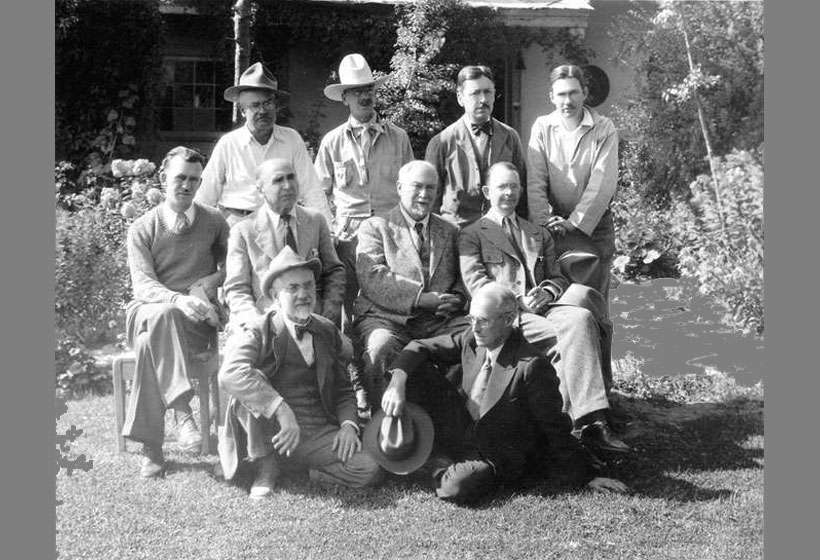 Former members of the Taos Society of Artists photographed by C.E. Lord in the Couse garden, 1932.  Back row: Ufer, Dunton, Higgins, Adams. Seated: Hennings, Phillips, Couse, Berninghaus. Front row: Sharp; Blumenschein. Missing: Critcher and Rolshoven.