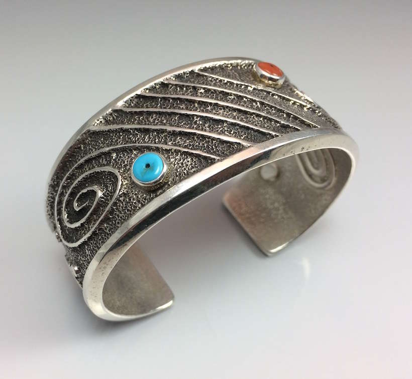 Robert Sorrell - Navaho | woman's bracelet | $800 | Sandcast silver with turquoise and coral; size 5 1/2 | courtesy of Mark Bahti, Bahti Indian Arts
