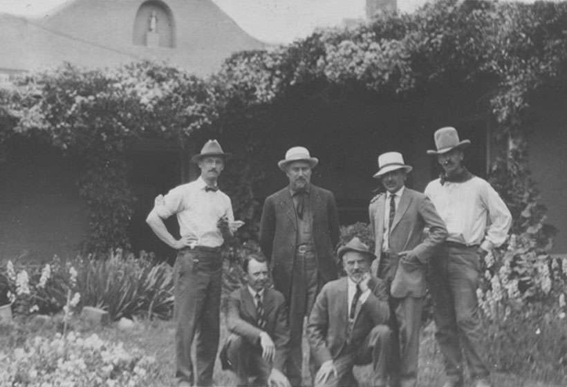 The six founding members of the Taos Society of Artists in Virginia Walker Couse's garden, 1915 (L-R, E.L. Blumenschein, O.E. Berninghaus, E.I. Couse, J.H. Sharp, B.G. Phillips, and W.H. Dunton)